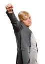 Exited young man raising clenched fist arm cheering her isolated on white Royalty Free Stock Photo