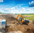 Exkavator working on construction site near the road Royalty Free Stock Photo
