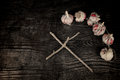 Exorcism still life a a wooden cross and garlic bulbs Royalty Free Stock Images