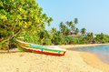 Exotic Asian beach with colorful boat, Sri Lanka Royalty Free Stock Photo