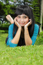 Exotic asian girl smiling and lying down Royalty Free Stock Photos