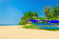 Exotic beach with colorful boat, tall palm trees Royalty Free Stock Photo