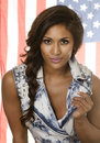 Exotic beautiful young woman in denim isa flag wearing hair pony tail usa american background Stock Image