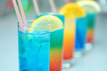 Exotic cocktails line of coctails with lemons and straws Stock Photo