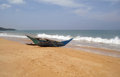 Exotic fisherman boat on beach near the ocean Royalty Free Stock Image