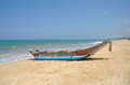 Exotic fisherman boat on beach near the ocean Stock Photography