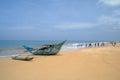 Exotic fisherman boat on beach near the ocean Stock Photos