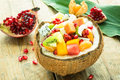 Exotic fresh fruit salad in coconut Royalty Free Stock Photos