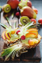 Exotic fruit salad served in half of pineapple Royalty Free Stock Photo
