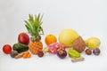 Exotic fruits isolated on white background. Healthy eating dieting food. Pitahaya, carambola, papaya, baby pineapple, mango, pass