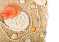 Exotic shell and pearls on sand Royalty Free Stock Photos