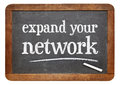 Expand your network advice on slate blackboard or reminder white chalk text a vintage Royalty Free Stock Image