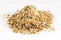 Expanded granulated animal feed cattle detail on white Stock Photography