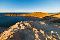 Expansive view at sunset on titicaca lake bolivia light the island of the sun among the most scenic travel destination in panorama Royalty Free Stock Photography