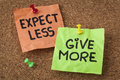 Expect less give more motivation or self improvement concept handwriting on colorful sticky notes Stock Photos