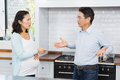 Expectant couple having argument in the kitchen Stock Images