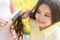 Expectant mother combing hair of her kid Royalty Free Stock Photo