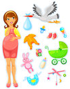 Expecting a baby pregnant woman with collection of items related to babies Royalty Free Stock Photos