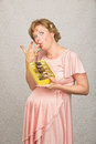 Expecting woman eating candy single pregnant with licking her fingers Stock Images