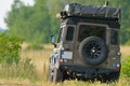 Expedition vehicle land rover defender with equipment Stock Images