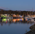 Expensive homes and boats ventura sunset over residential development by water in california with modern yachts Stock Image