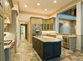 Expensive kitchen interior with granite counters and slate floor Stock Photography
