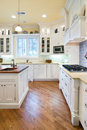 Expensive kitchen remodel with quartz counters and white cabinets Stock Image