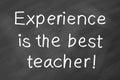Experience is the best teacher written by white chalk on blackboard Royalty Free Stock Image