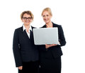 Experienced business corporates at work two ladies working on laptop Stock Photo