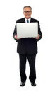 Experienced business person holding laptop Royalty Free Stock Images