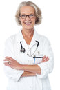 Experienced female physician cheerful lady doctor posing confidently Royalty Free Stock Photos