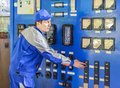 stock image of  An experienced operator service gas boiler equipment