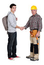 Experienced tradesman meeting new apprentice Royalty Free Stock Photo