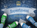 Experiment against blue chalkboard Royalty Free Stock Photo