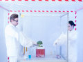 Experimenting with vegtables in the sterile chamber two scientists a containment tent a men and a woman on a piece of vegetable Royalty Free Stock Photo