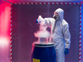 Experiments with steaming substances over waste barrel person in a protective suit and gas mask experimenting a blue plastic Royalty Free Stock Image