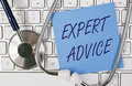 Expert advice a keyboard with a stethoscope and a note Royalty Free Stock Images