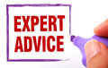 Expert advice text is signed by marker on white paper Stock Photography