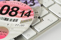 Expired uk vehicle tax disc on a keyboard motorists in the no longer have to display in the windscreen Stock Images
