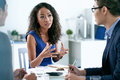 Explaining business idea pretty asian women her to male colleagues Stock Images