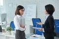 Explaining task vietnamese business women to her employee Stock Images