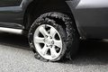 Exploded truck tire Royalty Free Stock Photo