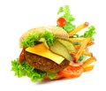 Exploded view of hamburger with french fries isolated on white background Royalty Free Stock Photo