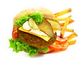 Exploded view of hamburger with french fries isolated on white background Stock Photos