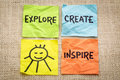 Explore create inspire and smile reminder on sticky notes against burlap canvas Royalty Free Stock Photos