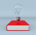 Explore new ideas front view of a book and a bulb concept of learning and exploring d render Stock Photo