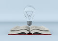 Explore new ideas one open book with a bulb concept of learning and exploring d render Royalty Free Stock Photos