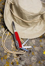 Explorer hat and swiss army knife Royalty Free Stock Photo