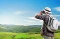 Explorer looking through binoculars outdoors Royalty Free Stock Photo