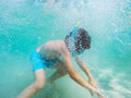 Exploring underwater child wearing snorkeling mask world Stock Image
